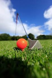 Photo d'une balle de golf et d'un club